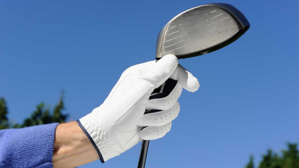 Golf glove holding driver