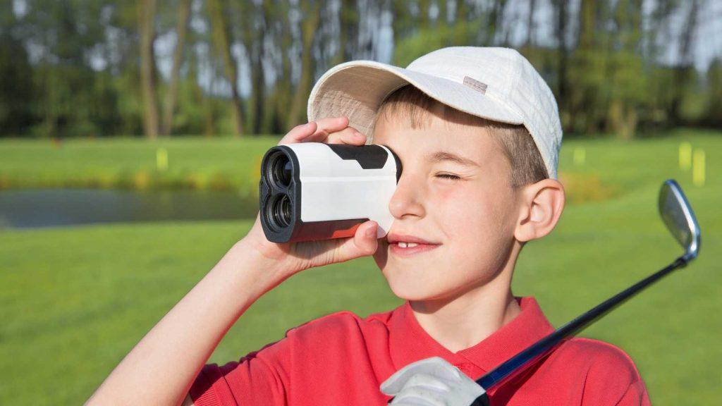Boy looking through Golf Rangefinder